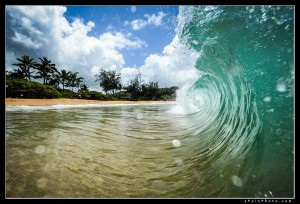 In the waves at Moloa'a Bay, Kauai.