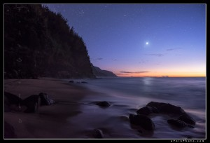 Stars appear over the Na Pali coast at twlight from Ke'e Beach, Kauai.