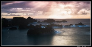 Long exposure seascape at sunrise with rock stacks in the ocean on Maui.