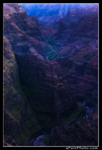 Twlight looking down Po'omau Canyon deep within Waimea Canyon on Kauai