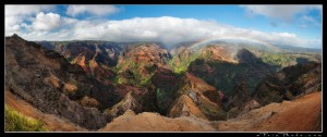 Waimea Canyon in late afternoon light with rainbow and waterfall