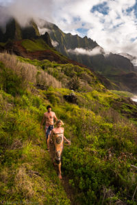 Wedding couple makes there way down the Kalalau trail with dramatic light