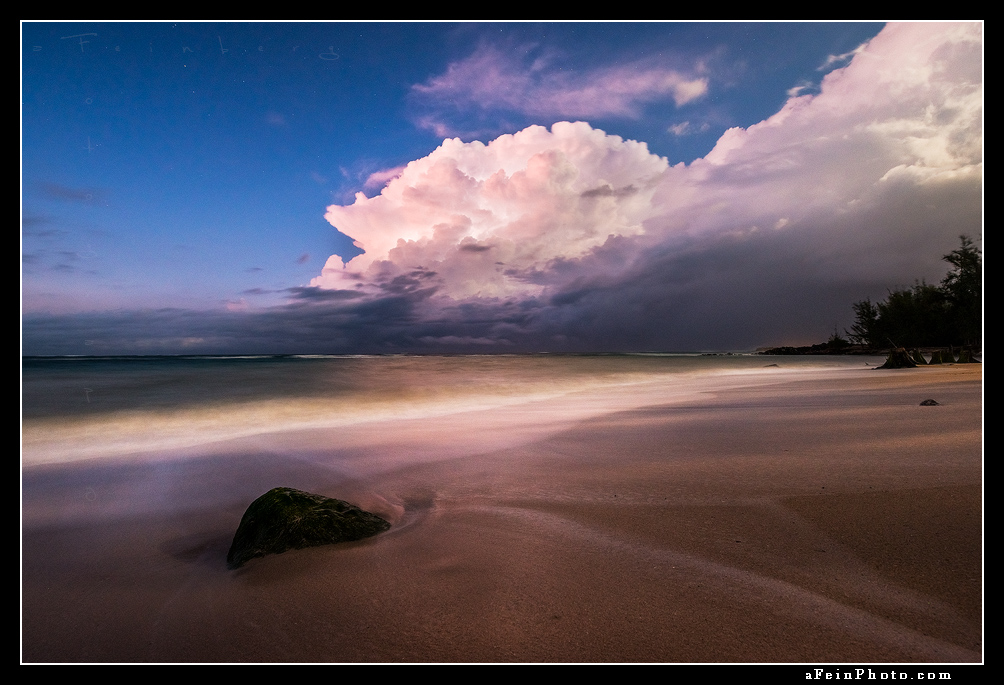Lightning illuminates a cloud over the ocean just off shore of Paia, Maui