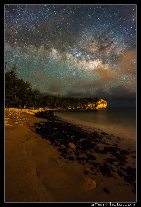 Milky way blazes over Shipwrecks Beach in Poipu, Kaua'i