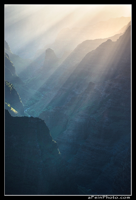 Dramatic beams of light enter Waimea Canyon.