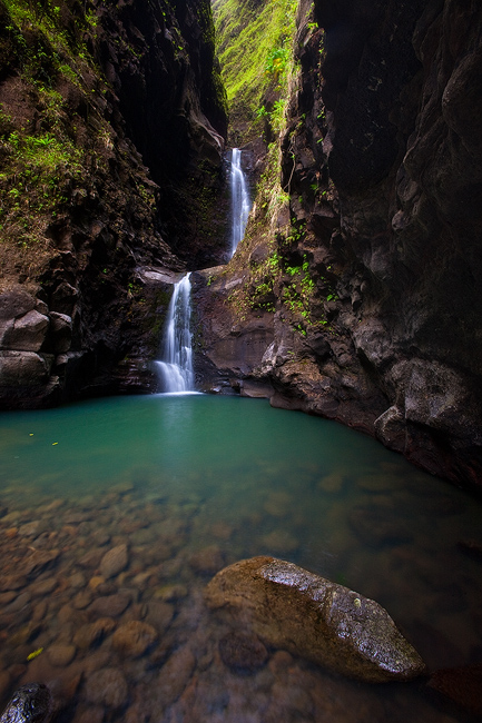 Hidden up inside of Kauai's east side Makaleha Falls offers a picture perfect place to relax, swim and enjoy the brilliant colored...