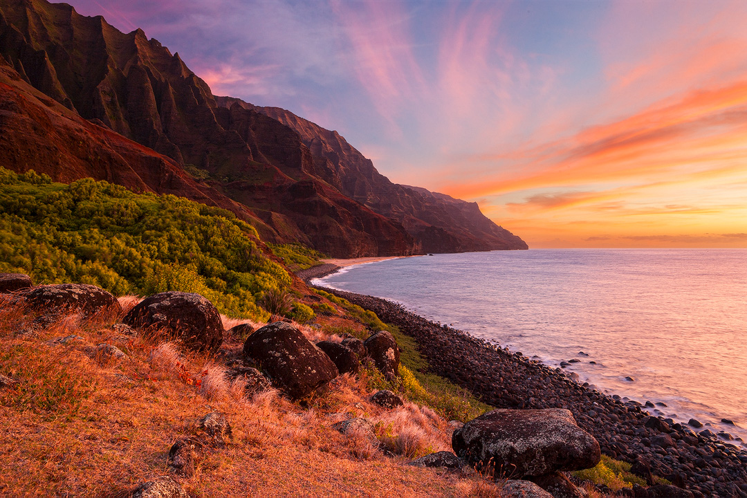 The sky explodes over the remote, rugged stretch of Na Pali coast called Kalalau. Limited Edition of 100. Artist Proof of 10.