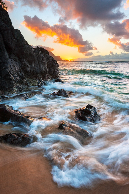 A lovely end to a lovely day on the north shore of Kaua'i.  Perfect timing with the sun setting just past Mt. Makana (Bali Hai...