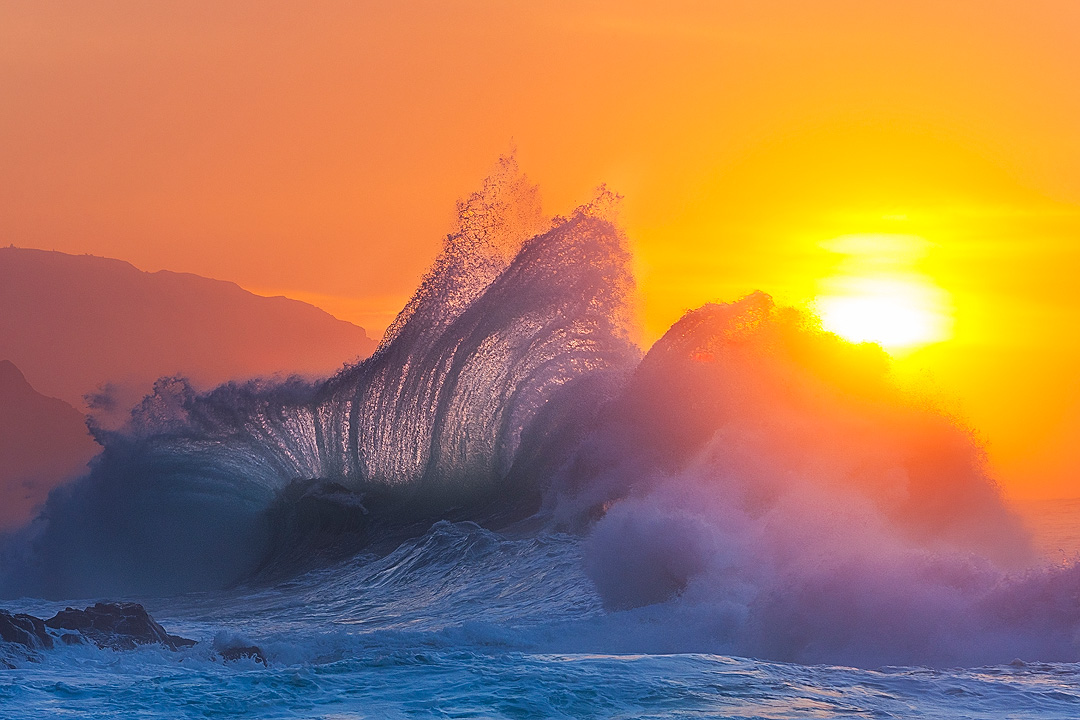 Waves collide along the Na Pali coast as the sun sets behind. To capture this scene I had to time both the right ocean conditions...
